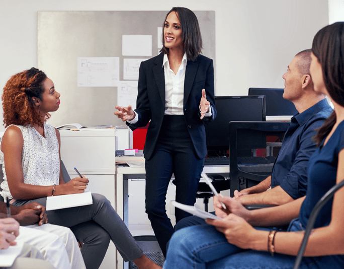 Female boss leading meeting main